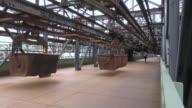 MS PAN Shot of tourist roaming at old steel mill at world heritage site Volklinger Hutte / Volklingen, Saarland, Germany