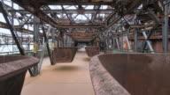 MS Shot of tourist roaming at old steel mill at world heritage site Volklinger Hutte / Volklingen, Saarland, Germany