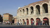 MS T/L Shot of Tourists roaming in front of Arena di Verona at Piazza Bra / Verona, Veneto, Italy