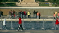 MS PAN Shot of tourists walking by water fountain at World War II Memorial / Washington, District of Columbia, United States