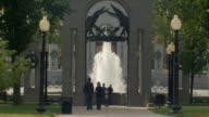 MS Shot of tourists walking towards water fountain at National World War II Memorial / Washington, District of Columbia, United States