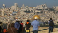 MS Shot of Tourists watching old city with dome of rock / Jerusalem, Judea, Israel