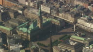 MS AERIAL Shot of tower of Hamburg city hall / Germany