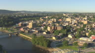 WS AERIAL Shot of town buildings and Crayola Factory / Easton, Pennsylvania, United States