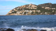WS Shot of town on mountain near ocean / Port d'Andratx, Mallorca, Balearic Islands, Spain