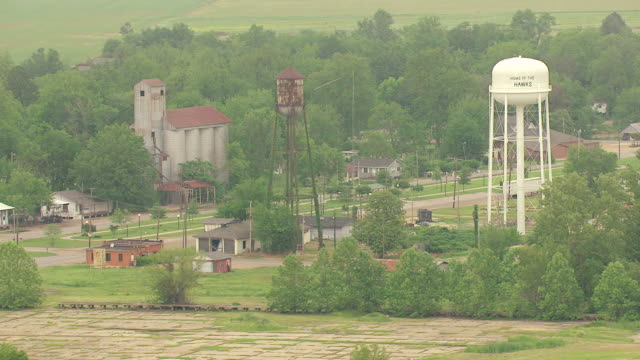 MS AERIAL Shot of town with tall water tower in Sunflower County / Mississippi, United States