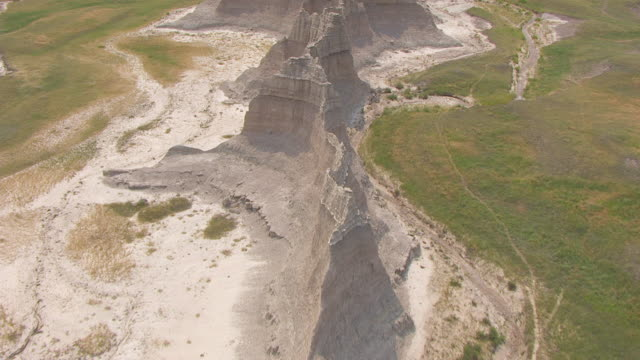 MS AERIAL Shot of track along Cliff Shelf view of Badlands in Shannon County / South Dakota, United States