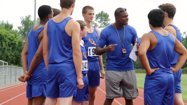 MS Shot of track coach gives team pep talk / Albany, New York, United States
