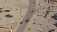 MS AERIAL PAN Shot of tracking bikers as they leave town / Sturgis, South Dakota, United States