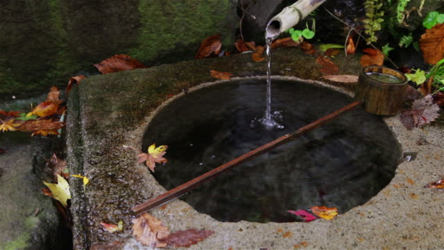 MS Shot of Traditional fountain at small mountainside shrine in Minakami rural area