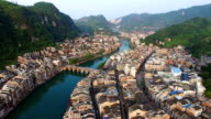 WS AERIAL shot of Traditional houses and bridge on Wuyang River,Guizhou,China.