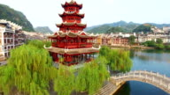 WS AERIAL shot of Traditional houses and pagoda along Wuyang River,Guizhou,China.