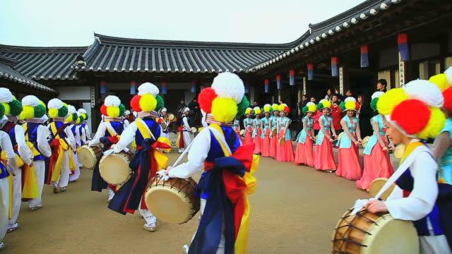 MS Shot of traditional Korean music performance group playing in Namsan Folk Village AUDIO / Seoul, South Korea