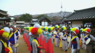 MS Shot of traditional Korean music performance group playing in Namsan Folk Village AUDIO / Seoul, South Korea