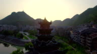 WS AERIAL shot of Traditional pagoda along Wuyang River at sunset,Guizhou,China.
