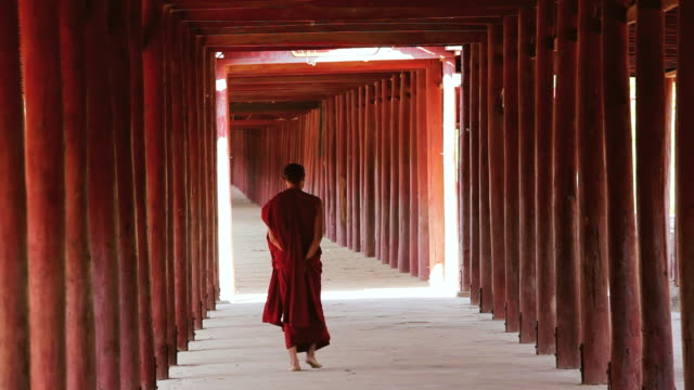 WS Shot of Traditionally dressed Monk in Buddhist temple walkway, Salay / Bagan, Burma
