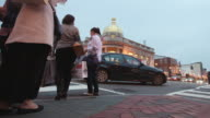 MS LA T/L Shot of Traffic and pedestrians at busy intersection in Georgetown neighborhood at dusk / Washington, District of Columbia, United States
