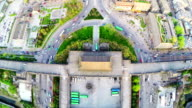 WS AERIAL Shot of traffic around west gates of citywall at sunset,Xi'an,China.