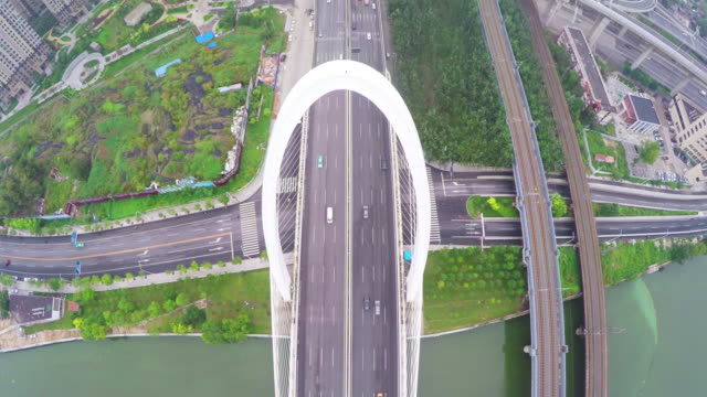 WS AERIAL shot of traffic moving on bridge and overpasses  ,Tianjin,China.