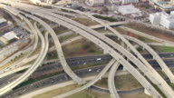 MS AERIAL Shot of traffic moving on highway Interchange of 20 and 85 / Georgia, United States