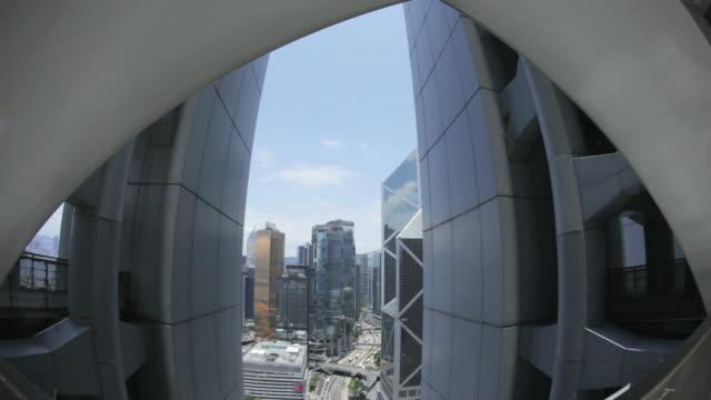 MS TD Shot of traffic moving on road through skyscraper in city / Hong Kong, Hong Kong, Hong Kong