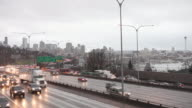 WS Shot of traffic moving on street at foggy rainy day during winter / Seattle, Washington, United States