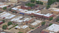 MS AERIAL Shot of traffic moving on street through stores / Cody, Wyoming, United States