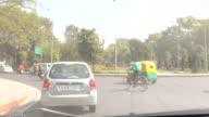 MS T/L POV Shot of Traffic on city street / Delhi, India