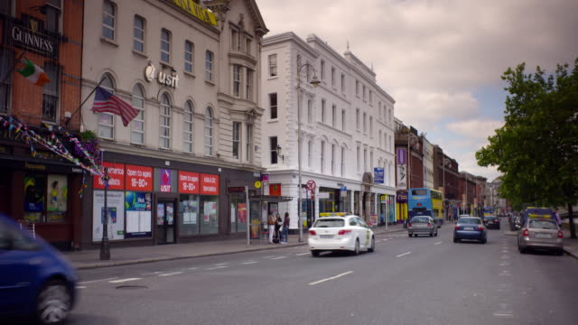 Shot of traffic traveling down Westmoreland Street in Dublin, Ireland on a summer day