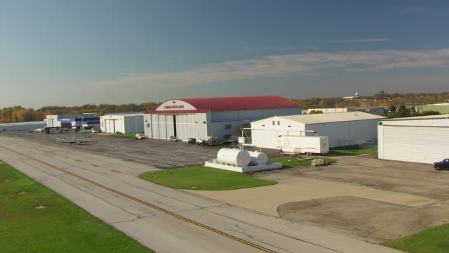 WS ZI AERIAL Shot of trailer with birthplace of aviation sign at Dayton Wright Brothers Airport / Dayton, Ohio, United States