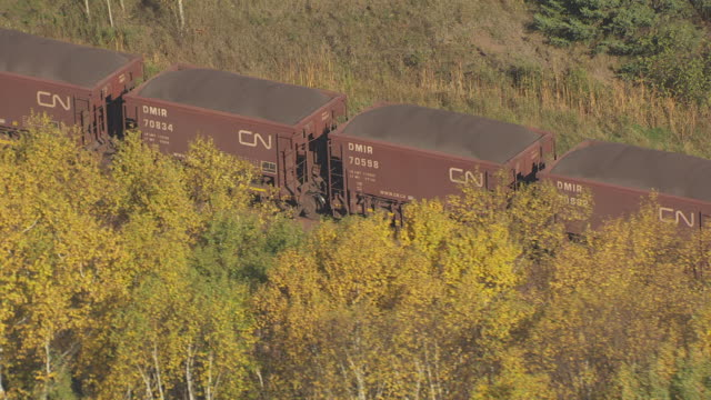 CU AERIAL Shot of train cars filled with ore traveling on tracks / Minnesota, United States