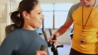 MS TD TU Shot of trainer working with client in gym / Santa Fe, New Mexico, United States