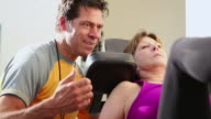 MS Shot of trainer working with client in gym / Santa Fe, New Mexico, United States