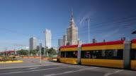 WS Shot of Trams and traffics at Palace of Culture and Science / Warsaw, Masovian Voivodeship, Poland