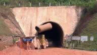 MS Shot of transport passing in mine at village / Serra Pelada, Para, Brazil