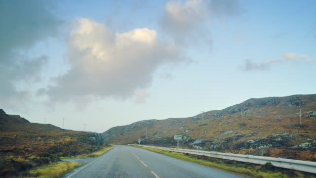MS POV Shot of travelling along road through heathland and hills / Drumbeg, Scotland, United Kingdom