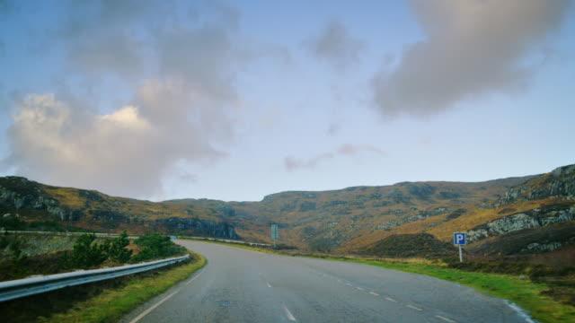 MS POV Shot of travelling along road through heathland and hills / Drumbeg, Scotland, United Kingdom