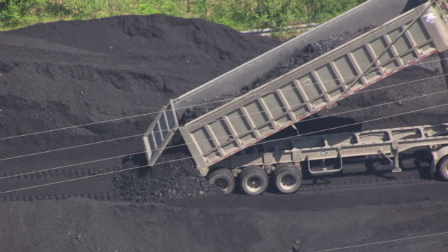 MS AERIAL ZO Shot of truck unloading coal at dock in East Kentucky / Kentucky, United States