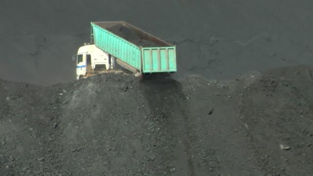 MS Shot of truck unloading coal / Teruel, Spain