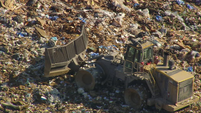 CU AERIAL Shot of truck working at Landfill (outside Fairmont Mill) / South Carolina, United States