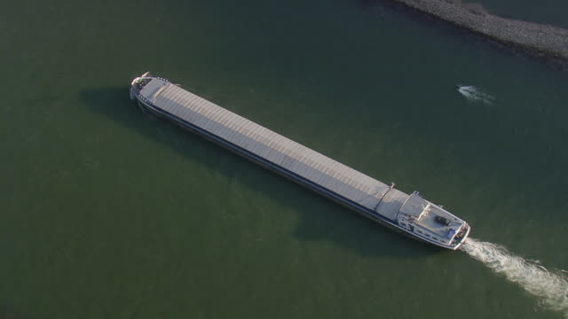 MS AERIAL DS Shot of tug boat moving in river at Rhine Valley / Germany