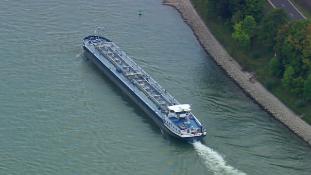 MS AERIAL Shot of tug boat moving in river at upper middle Rhine valley / Germany