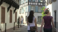 MS Shot of Turists walking at Old town Petite France, Rue du Baines aux Plantes / Strasbourg, Alsace, France