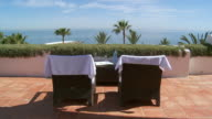 MS Shot of two deck chair on patio / Marbella, Andalusia, Spain