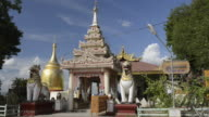 MS Shot of Two lion (Chinthe) as temple guard in front of Bupaya temple with golden stupa at Ayeyarwady river / Bagan, Mandalay Division, Myanmar