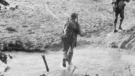 MS Shot of two soldiers crossing river bed