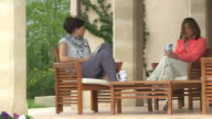 MS Shot of two woman relaxing at holiday villa / Puerto Pollenca, Mallorca, Balearic Islands, Spain