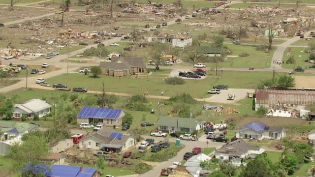 MS AERIAL ZI TD Shot of undamaged homes and neighborhood to reveal tornado damage with wreckage / Smithville, Mississippi, United States