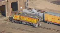 MS AERIAL TS Shot of Union Pacific train car at Cheyenne UP Railroad Depot / Wyoming, United States