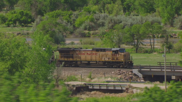 MS AERIAL TS Shot of Union Pacific train en route and circle around train near Chimney Rock / Nebraska, United States